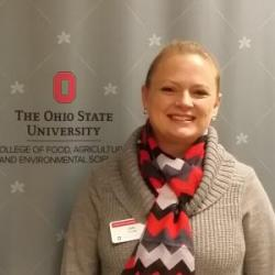 Image of Team Member Amy Stone with OSU Logo backdrop